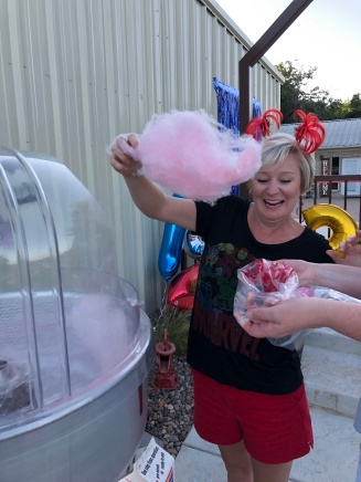 Misha getting cotton candy ready for movie time