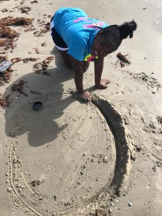 Biv building her sand castle.