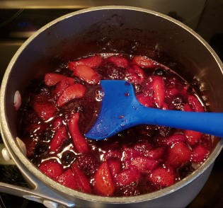 Fruit has cooked down and syrup thickens.