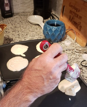 Husband cooking the pancakes. Nothing but love here!