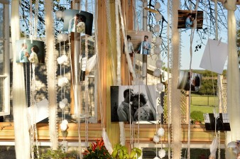Photos of happy couple hanging in the greenhouse.